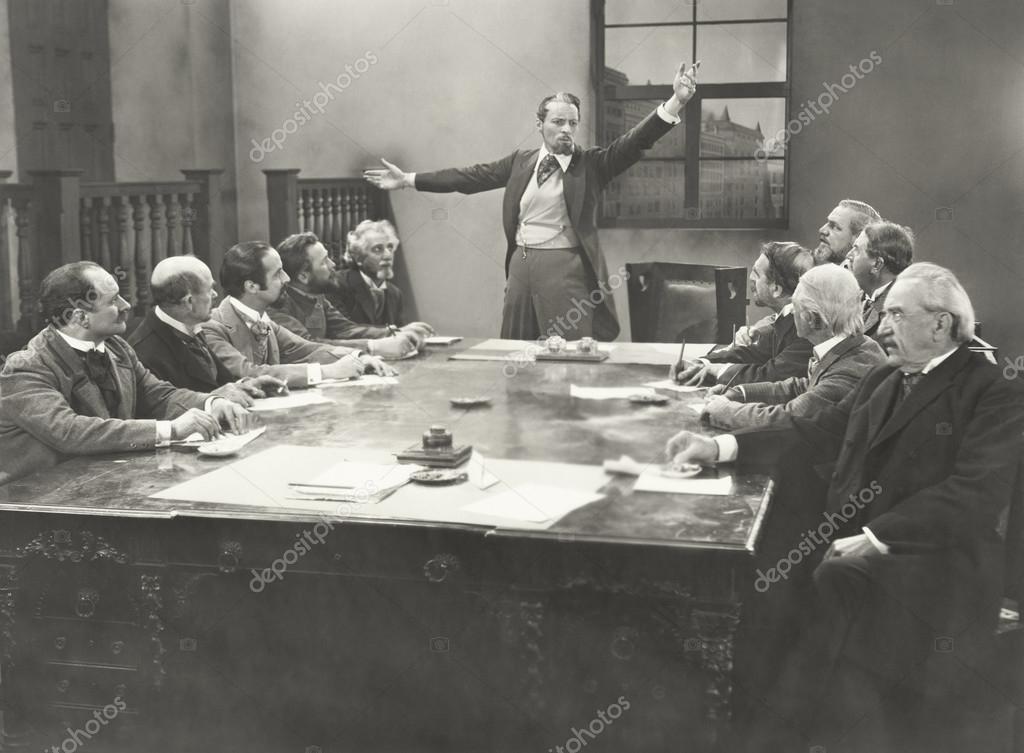Businessmen in board room