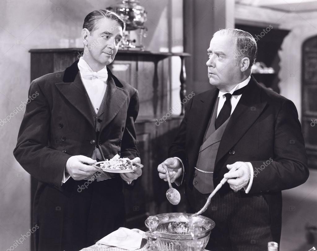 Butler serving salad