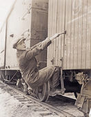 hobo climbing freight train