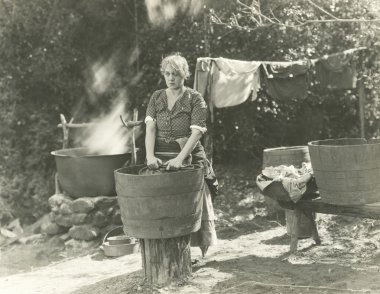 Woman washing outdoors
