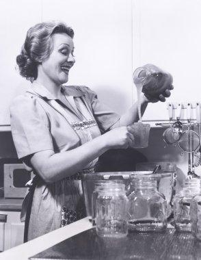 Woman measuring preserves