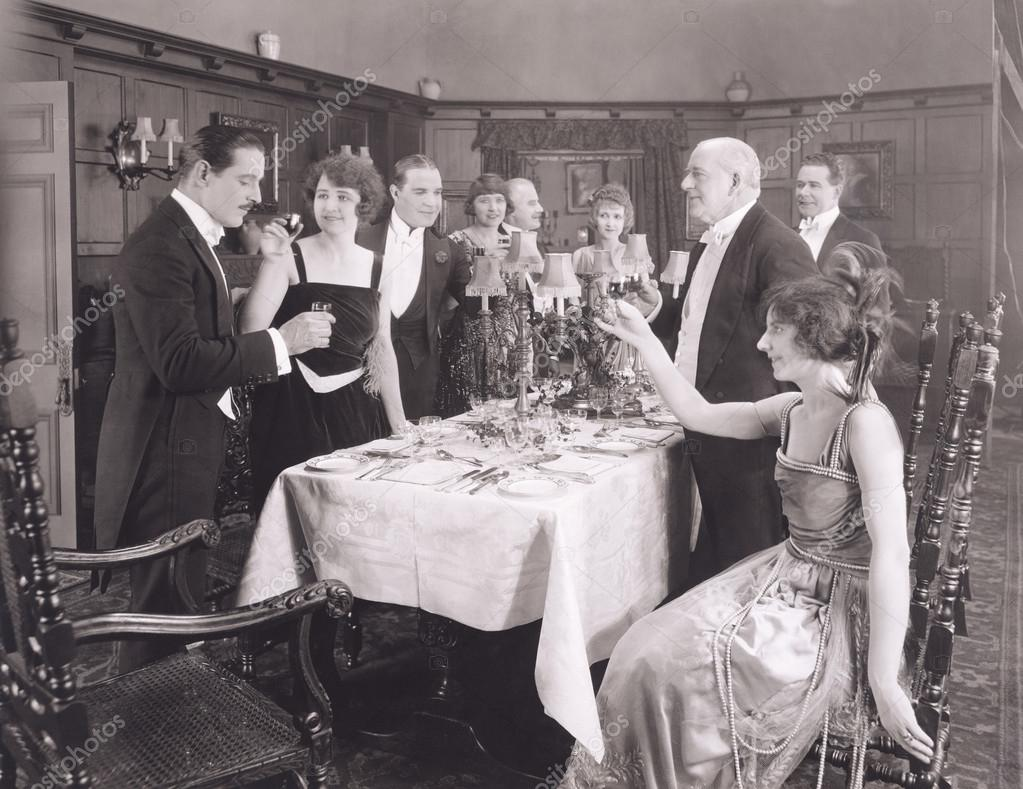 Toasting the host of dinner party