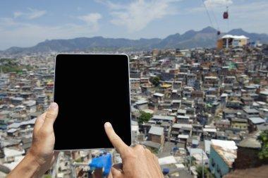 Hands Using Tablet at Brazilian Favela Urban Slum Rio de Janeiro