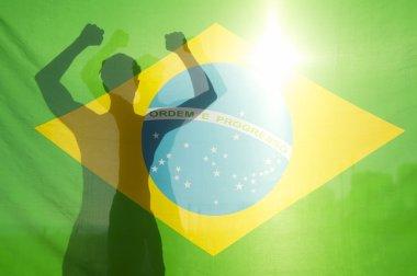 Brazilian Celebrating Arms Raised Behind Flag
