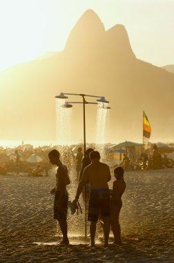 Brazilian Men Showering at Sunset Ipanema Rio