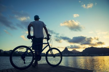 Sunset Silhouette of Man with Bicycle Lagoa Rio de Janeiro Brazil