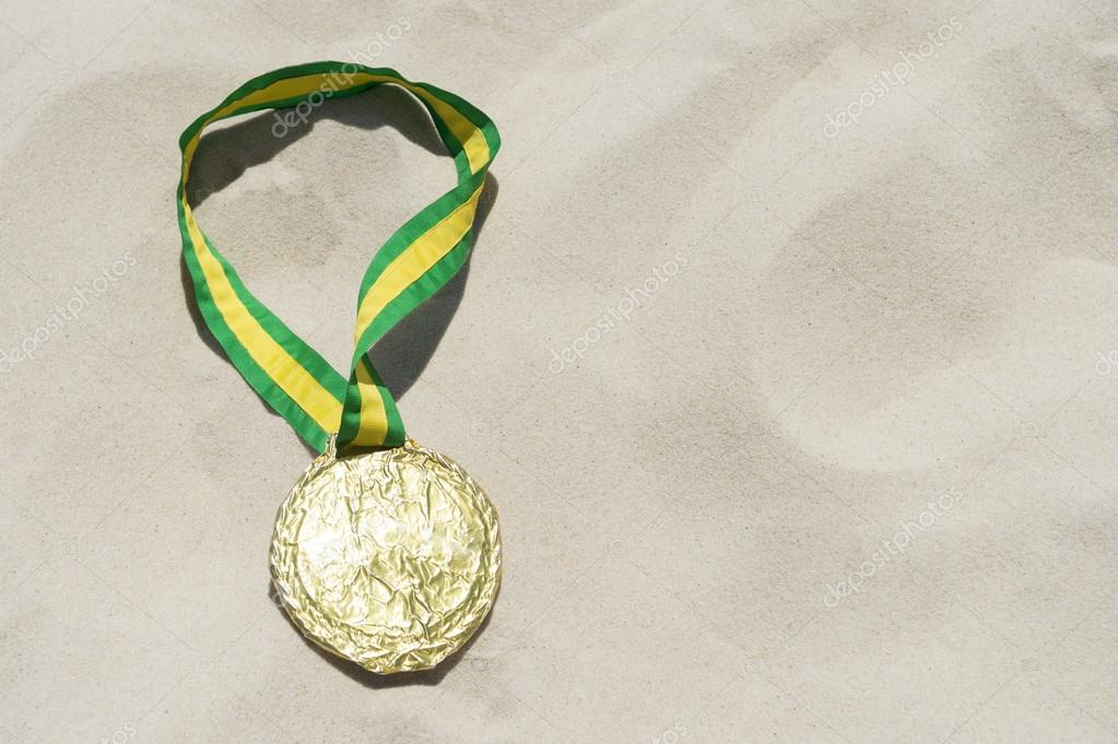 Gold Medal with Brazil Colors Ribbon in the Sand — Stock
