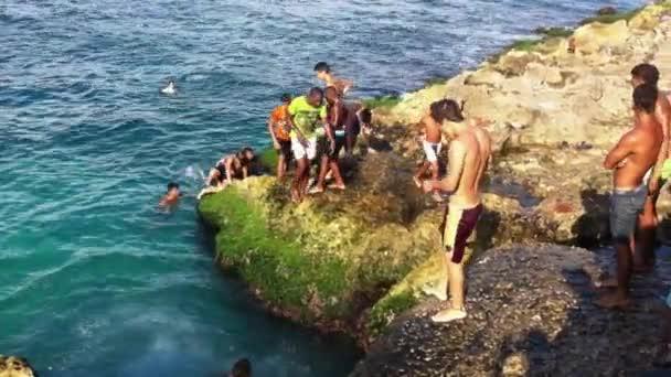 Young Cubans Jumping in the Sea in Havana Cuba