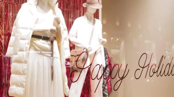 Clothing store window female winter season fashion holidays style