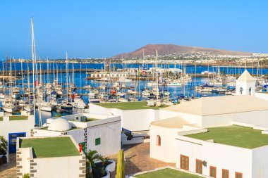 View of marina Rubicon and typical Canary style houses in Playa Blanca town