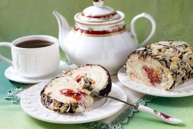 Sponge roll with cream cheese and cherry jam