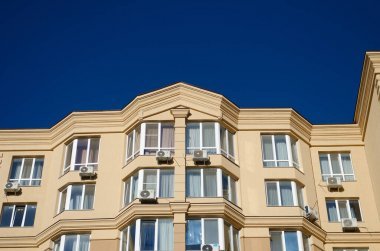 Multi-storey house against the blue sky. Background