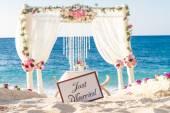 Fotografie beach wedding set up, tropical outdoor wedding reception, beauti