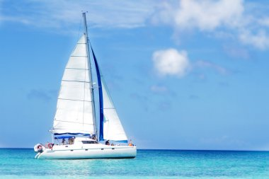 sea yacht on tropical sea and sky background