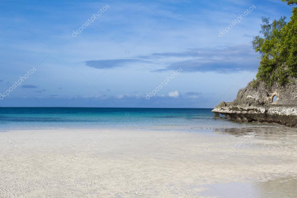 tropical beach seascape with blue sky