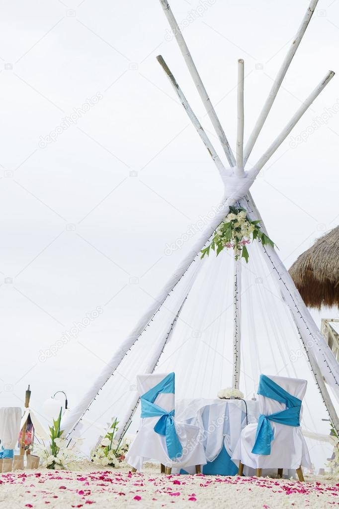 wedding arch, decorated table and set up on beach