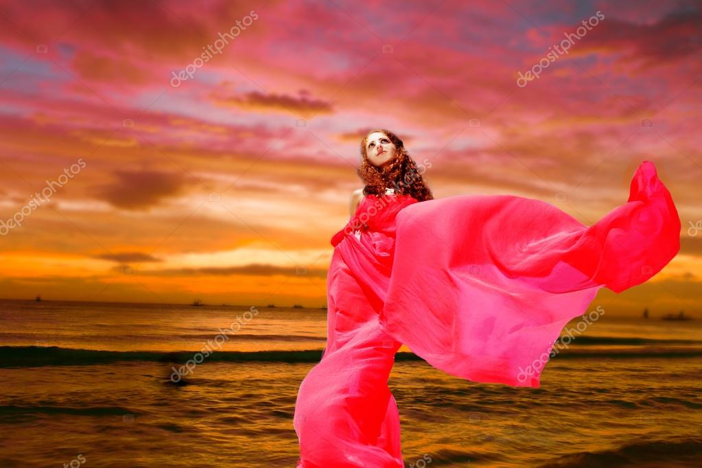 Young beautiful woman in red dress on tropical sea sunset background stock vector