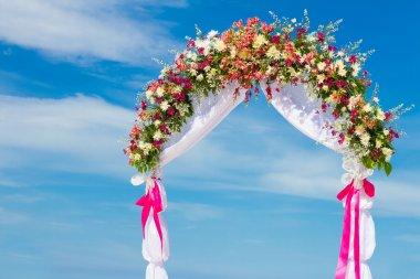 wedding arch, cabana, gazebo on tropical beach decorated with fl