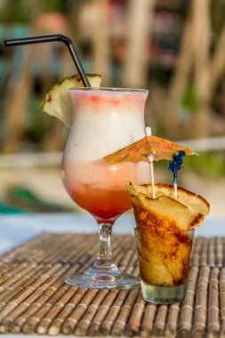 pina colada cocktail on tropical outdoor background