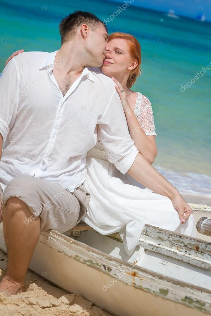 young loving couple on beach background, wedding day, outdoor be