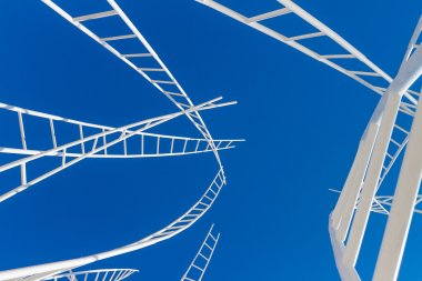 maze of white ladders isolated over blue sky