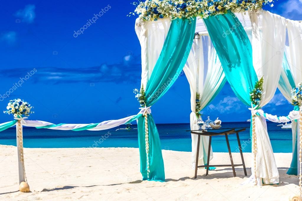 beach wedding venue, wedding setup, cabana, arch, gazebo