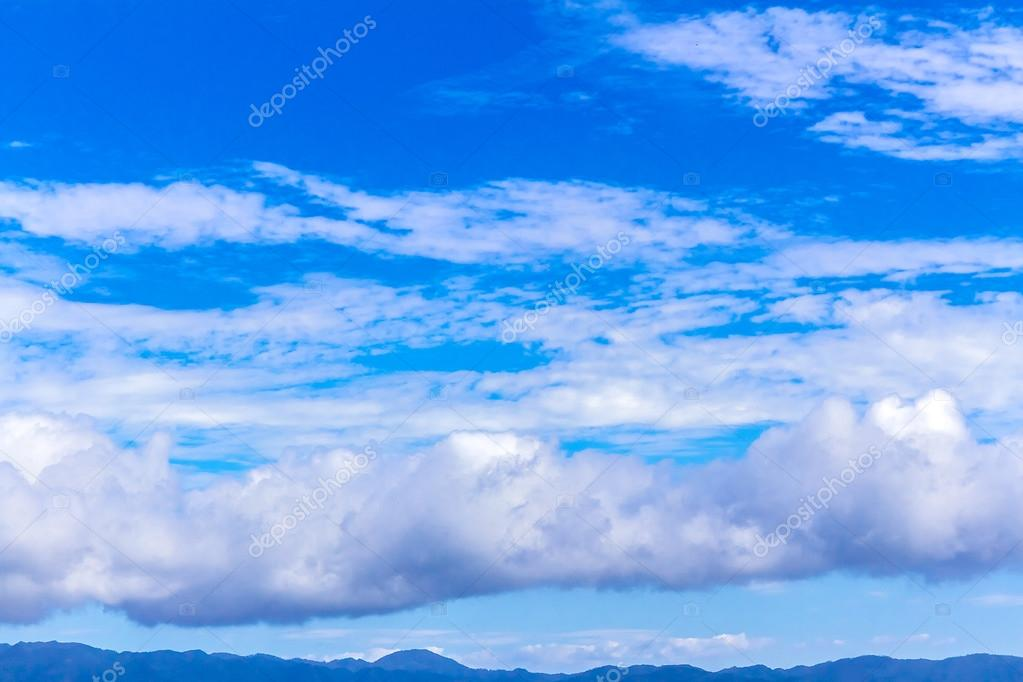 blue sky with white fluffy clouds, beautiful cloudscape