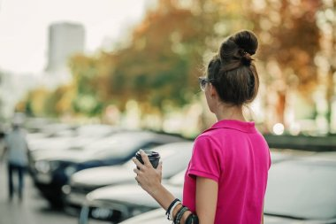 Cities and Mental Health. Living in big, cities, increased population density, traffic noise, metropolis pollution. Brunette young woman on the street of big city, megalopolis