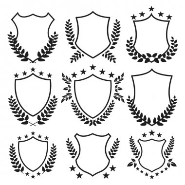 Medieval shields with stars and laurel wreaths set. Trophy, awards, vintage insignia shields collection. Black color. Premium quality. Vector illustration isolated on white background stock vector