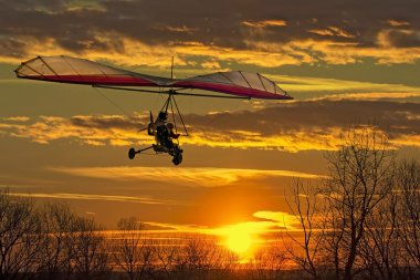 Hang glider fly in the sunset