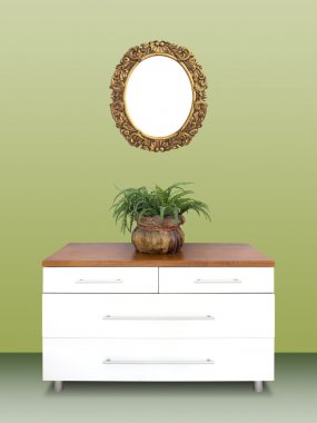 Modern chest of drawers and gilded Frame on wall