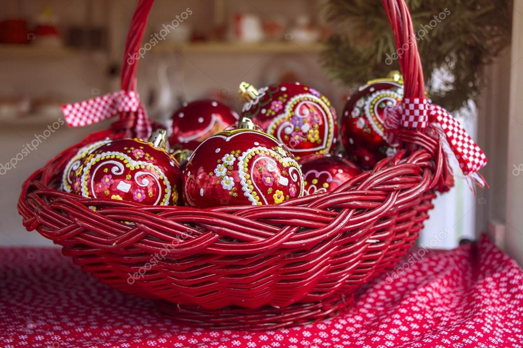 red christmas balls in basket decorated with gingerbread heart a traditional croatian decorations photo by smuki