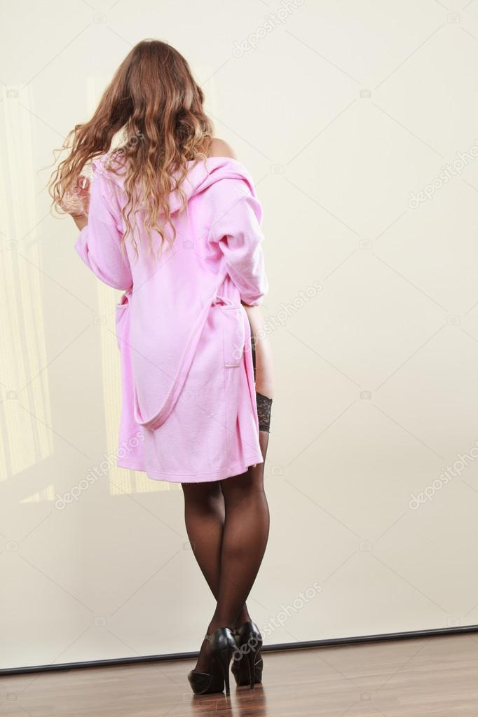 Seductive lady in dressing gown. — Stock Photo © Voyagerix #104351166