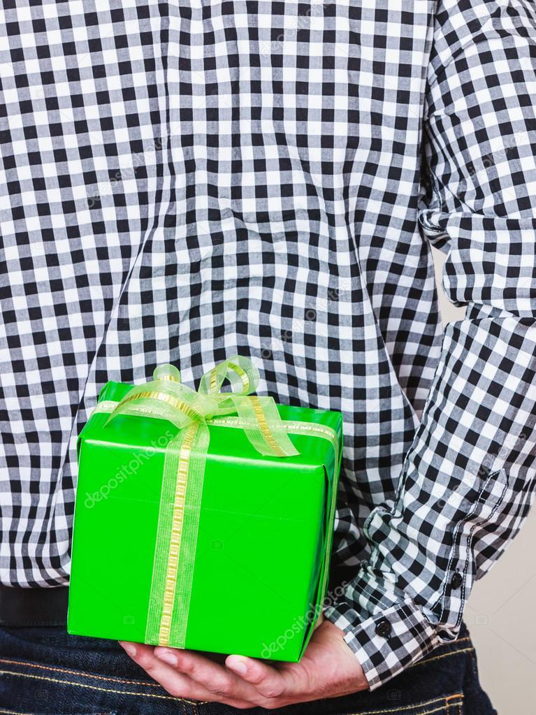Man Hiding Gift Box Behind Back Birthday Surprise Stock Photo