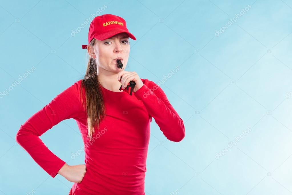 99fe98183cf Lifeguard woman girl in red cap on duty supervising swimming pool water  blowing whistle on blue. Accident prevention rescue. — Photo by Voyagerix