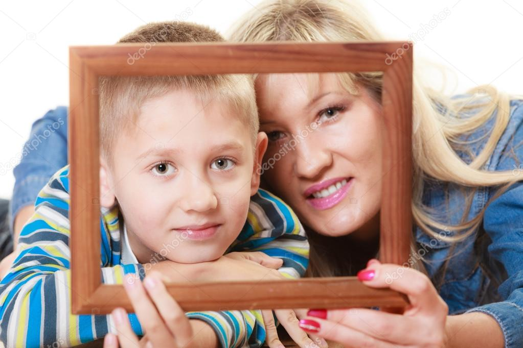Mother And Son Holding Frame Stock Photo Voyagerix 63014581