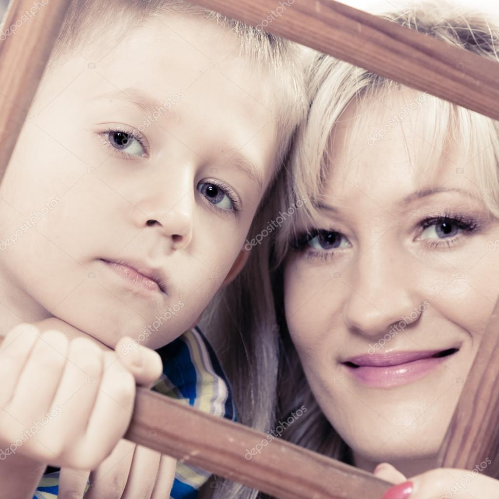 Mother And Son Holding Frame Stock Photo Voyagerix 65401687