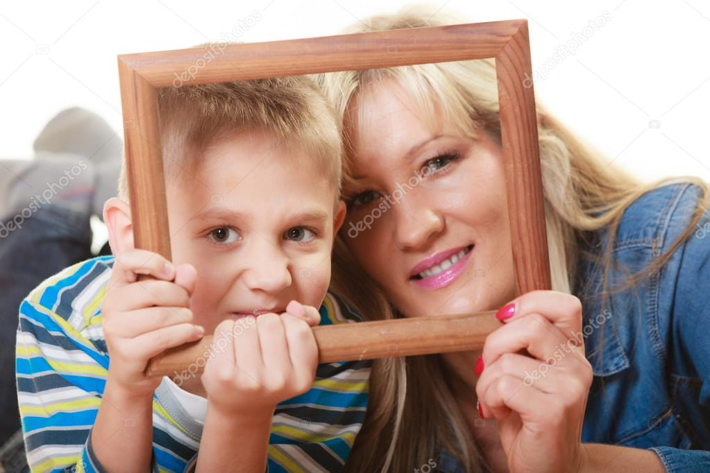 Mother With Son Holding Frame Stock Photo Voyagerix 75783969