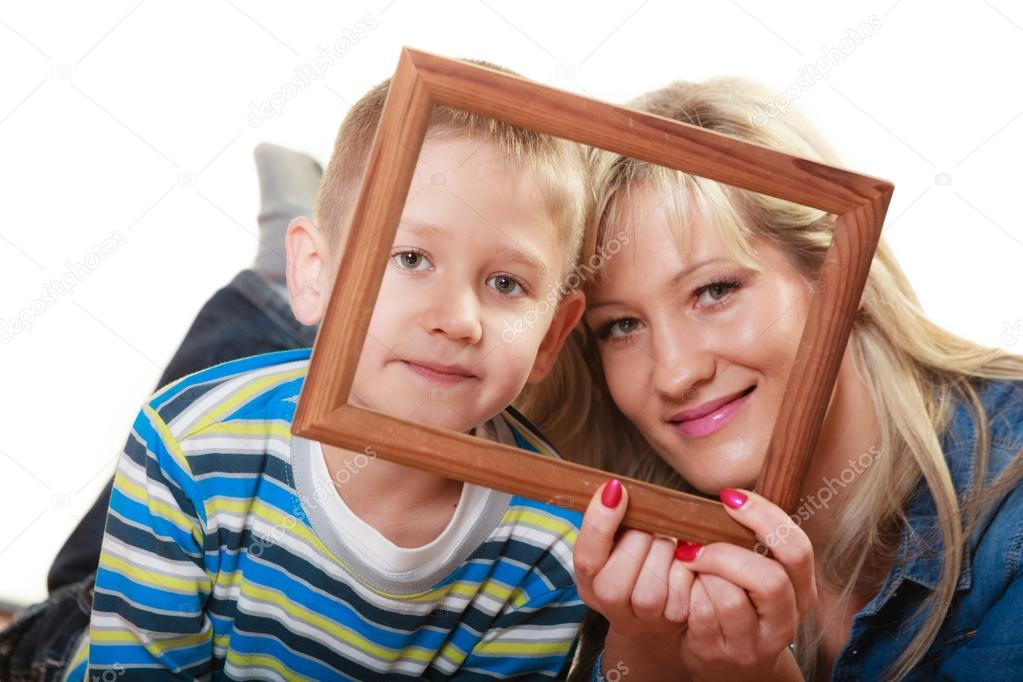 Mother With Son Holding Frame Stock Photo Voyagerix 80891802