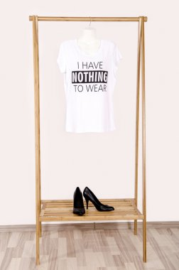Wardrobe with an empty rack with noting to wear t-shirt.