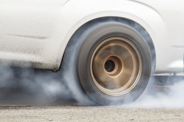 Race car burns rubber off its tires