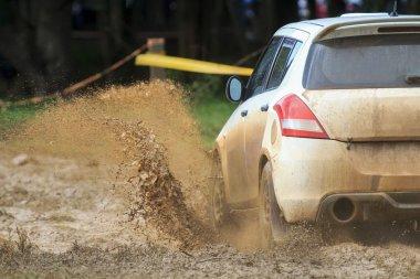 Rally car in muddy road