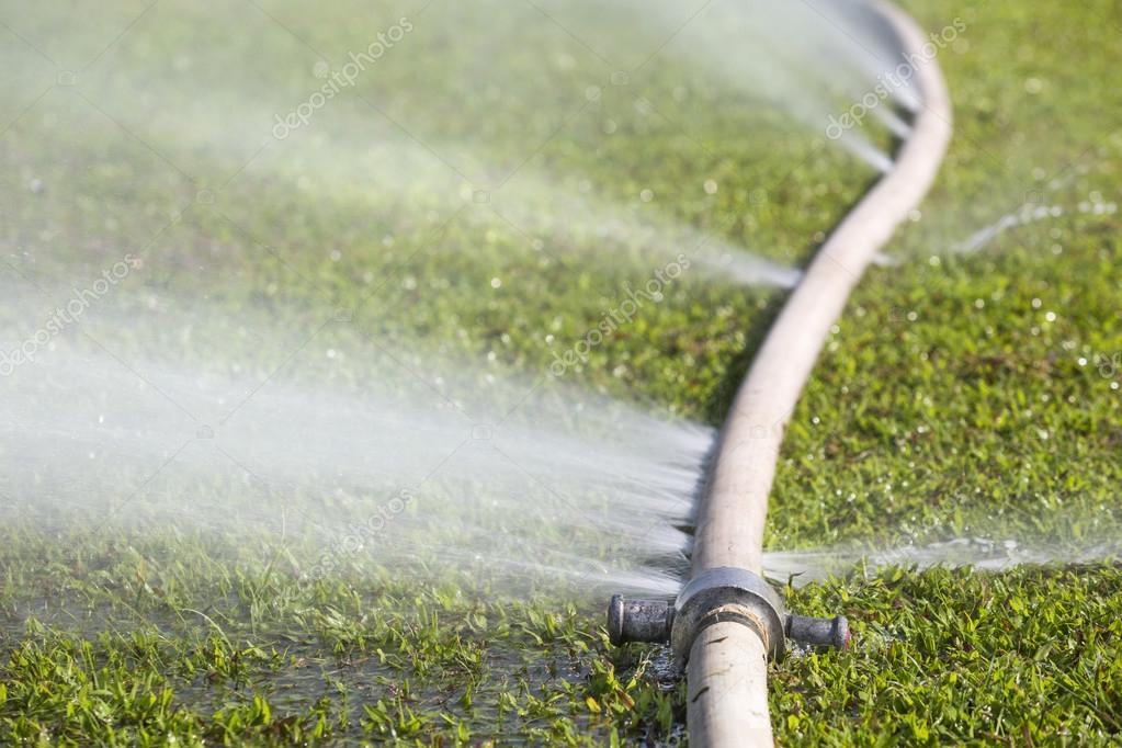 Wasting Water Water Leaking From Hole In A Hose Stock Photo Toa55 87317502