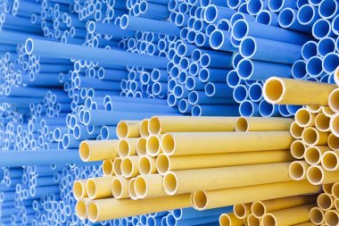 PVC pipes for electric conduit (yellow) and water (blue)