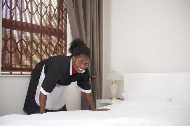 Pretty housemaid in uniform