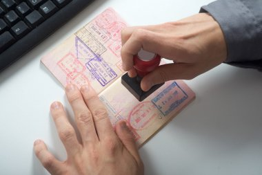 Officer will stamp in the passport