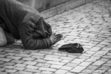 man begging for money, black and white