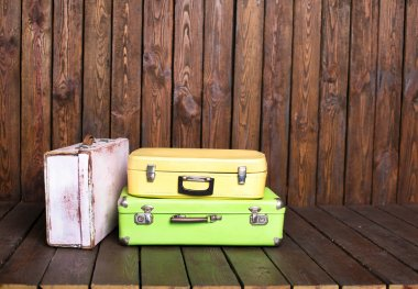 Suitcases on wooden table