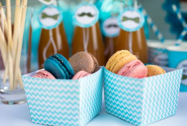 Colorful French macaroons in boxes