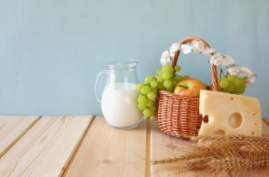 dairy products and fruits on wooden table